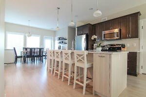 NEW 3 Bed, 2.5 Bath Main Floor Suite with yard, deck and garage!