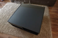 Black and Glass Coffee Table with great storage on castors