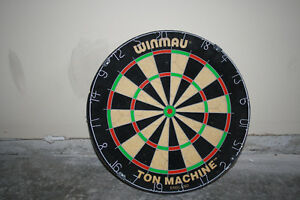 Official dart board comes with darts