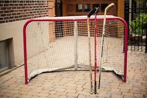 Hockey net and hockey sticks