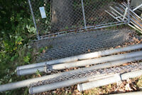 Chain link fence with posts and door.