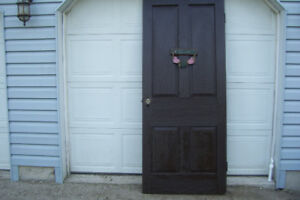 1940S SOLID WOOD PANNELL DOOR PAINTED VERY HEAVY MAY BE OAK.