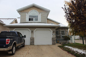Fully renovated home with 2 heated double garages!