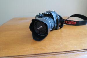 Pentax k-x + zoom  smc  Pentax -DAL 18-55mm AL  (negotiable)