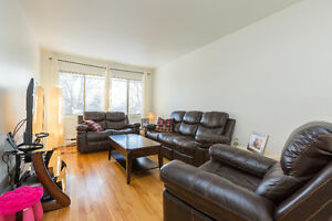 beautiful main floor 5 1/2 with large terasse and parking spots