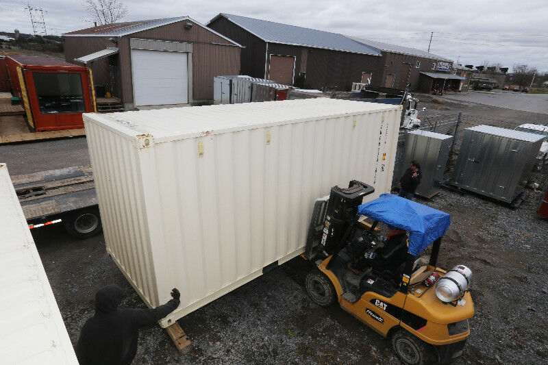 Various Used And New Shipping Containers Located In