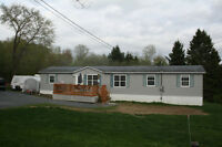 3 Bedroom Mini Home on own 1 1/2+ acre lot.