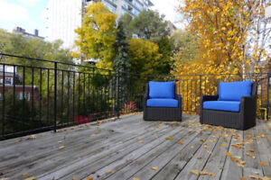 Pair of Crate and Barrel wicker swivel patio chairs