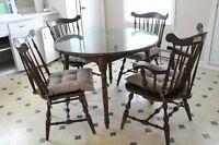 Antique colonial wood dining set with glass top and 4 chairs