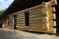 HAND CRAFTED CEDAR LOG HOME KIT including onsite assembly.