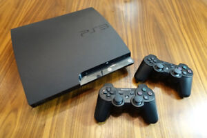 PS3 Slim 120GB + 2 controllers + 18 games + 2 wireless guitars