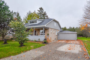 A charming limestone century home situated on a beautiful lot!