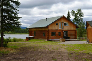 Lakefront property with 2 log homes and 2 log cabins on 135 acre