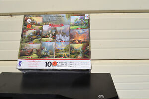 BOX OF 10 Thomas Kinkade Puzzles Each Puzzle is COMPLETE