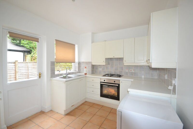 Newly refurbished one double bedroom flat with small paved patio .