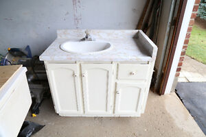 Vanity, Sink, and Faucet In Fine Shape