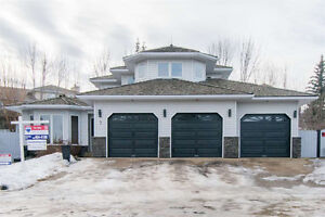 Heated Triple Garage and A Huge Pie Shaped Lot - 5 Bedroom Home
