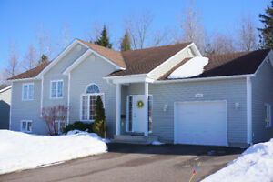 In the heart of Dieppe with a private wooded backyard!!