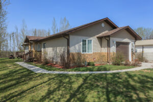 Nearly new 3 bdrm bungalow located in a quiet town!