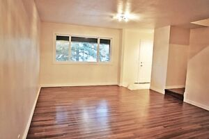 Northside 4 bedrooms renovated 2 parkng stalls walk 2 bus/school