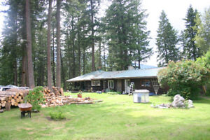 2200 sqft freehold log house on 11.5 flat acres for sale.