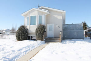 2+2 BR raised bungalow w/ dbl garage beside large greenspace.