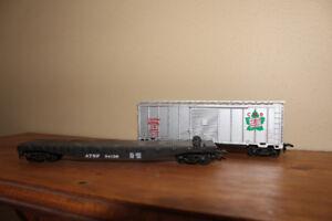 Two HO model scale train cars