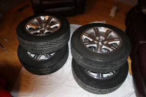 4 Goodyear Triple Tread 215/65R17 tires with rims