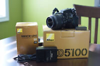 Nikon D5100 with 15-55mm VR Lens, all original boxes and accesso