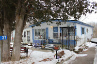 AFFORDABLE 2 BEDROOM DOUBLE-WIDE IN YEAR-ROUND PARK