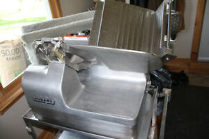 Commercial meat/cheese slicer.  Automatic fast feed.