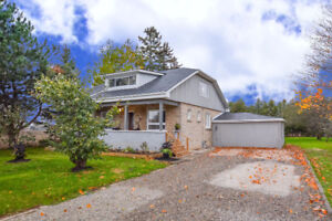 Charming limestone century home situated on beautiful 1/3 acre