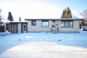 4 bdrm 2 bath bungalow in NECH w/garage