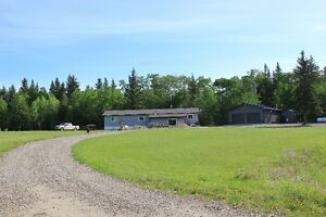 Great Acreage with Large Heated Shop outside of St,. Walburg!