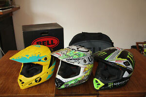 Three Bell Moto 9 helmets for sale.