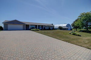 GORGEOUS Home on 12.5 acres with In-Law Suite & Huge Cover-all!