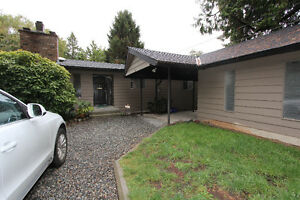 Spacious 1 Level 3 Bed 7 Den Home, with a huge back yard
