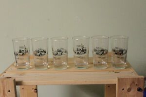 Six Glass collectible car glasses.  Two cars per glass