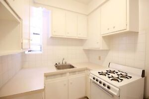 LARGE 4 1/2 with BRICK WALL! Heating & Appliances incl.