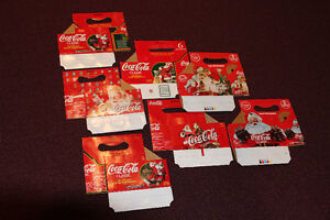 REDUCED - 7 Coca-Cola Christmas bottle carriers