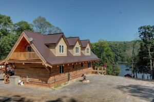 ***Waterfront Paradise*** Newly built Ecolog home on 12.5 acres