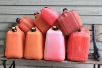 assortment of approved gas cans