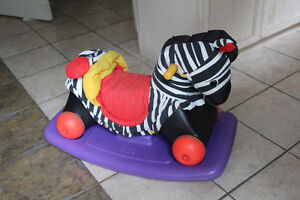 Zebra rocker converts to drive around toy