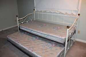 Single day bed with trundle bed including mattresses