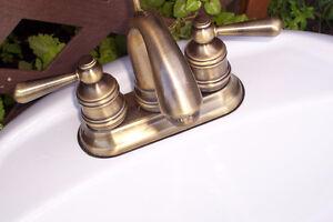 White Bathroom sink with Bronze/Brass Taps (Moen)