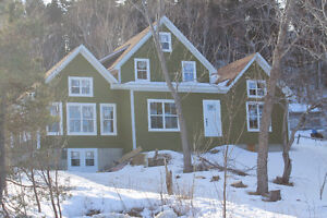 OCEAN VIEW, HUGE MATURE LOT and AMAZING OPEN CONCEPT LIVING!