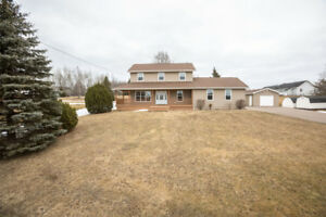 IMMACULATE TWO STOREY HOME WITH 2 GARAGES