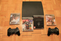 Playstation 3 - 2 controllers - 4 games (Skyrim, Uncharted 3...)