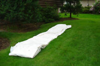 large white tarp/plastic approx. 30 by 35 feet