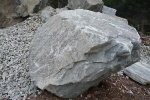 NATURAL grey BOULDERS & flat limestone for landscaping projects.